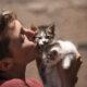 volunteer kissing kittens